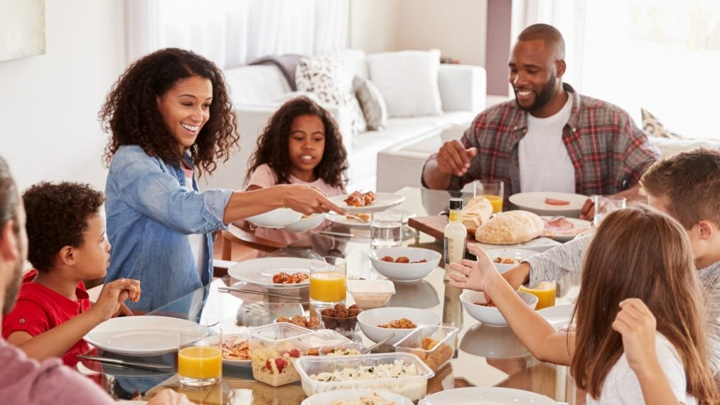 Family engaging with kids over a meal